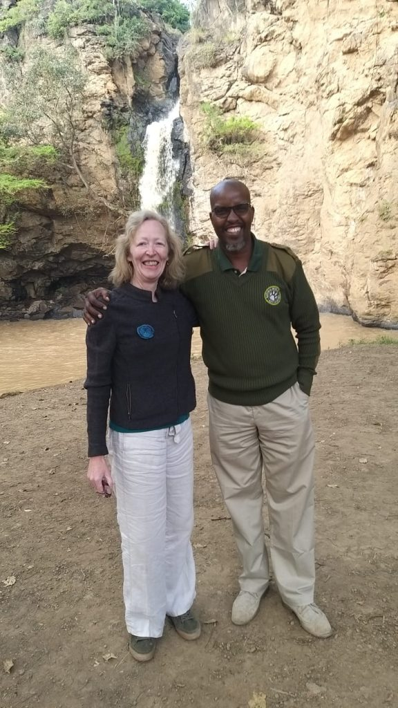 Joseph Mbotte with guests at Makalia falls, Lake Nakuru National Park in Kenya