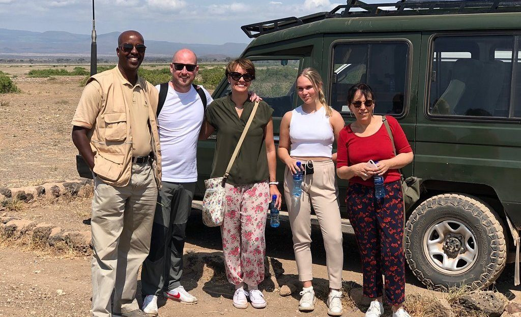 Joseph Mbotte with guests at Maasai Mara National Reserve in Kenya
